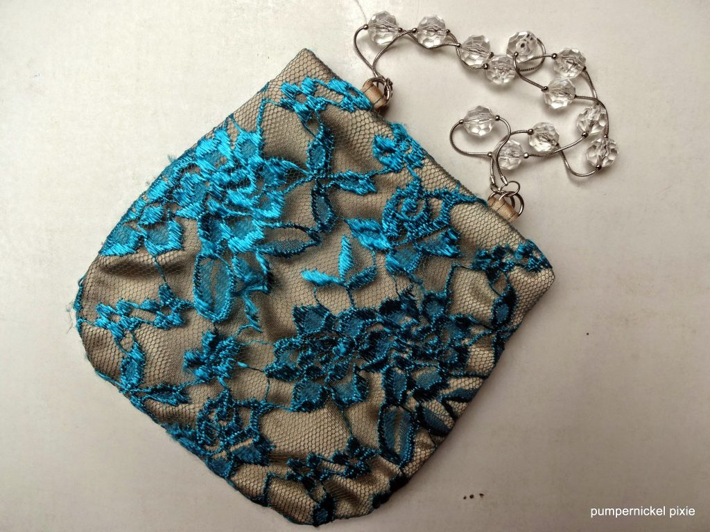 teal gold lace silk purse pearls string pumpernickel pixie
